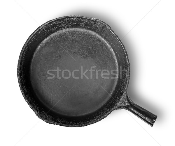 Empty old cast iron frying pan Stock photo © Cipariss