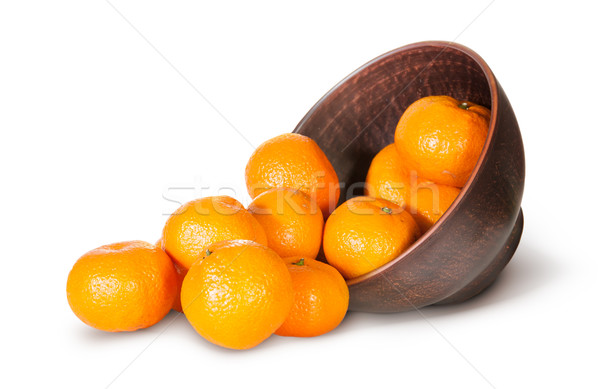 Tangerines Spill Out Of Clay Bowl Stock photo © Cipariss