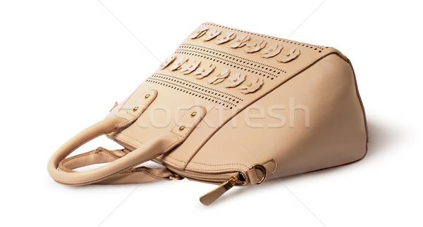 Elegant leather beige handbag lying Stock photo © Cipariss