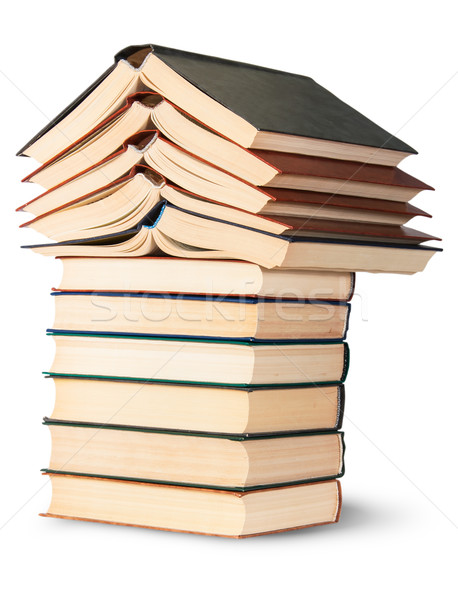 Stock photo: Stack of open and closed old books rotated