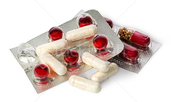 Halom tabletták kapszulák csomag izolált fehér Stock fotó © Cipariss