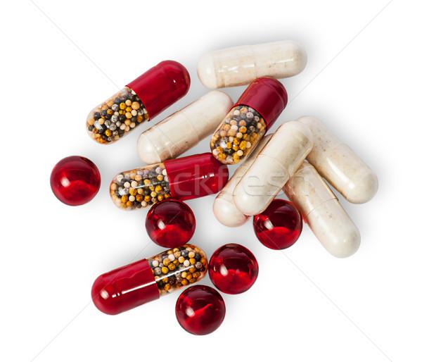 таблетки капсулы различный цвета изолированный белый Сток-фото © Cipariss
