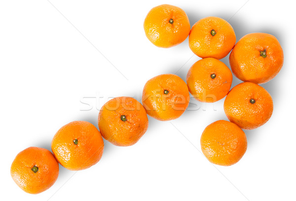Stock photo: Ripe Juicy Orange Tangerine Lined As A Arrow