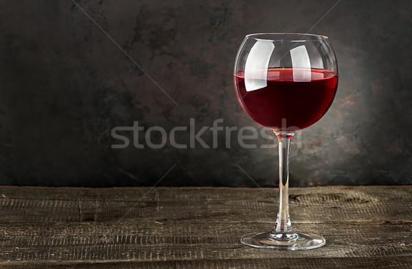üveg vörösbor fa asztal sötét homályos bor Stock fotó © Cipariss