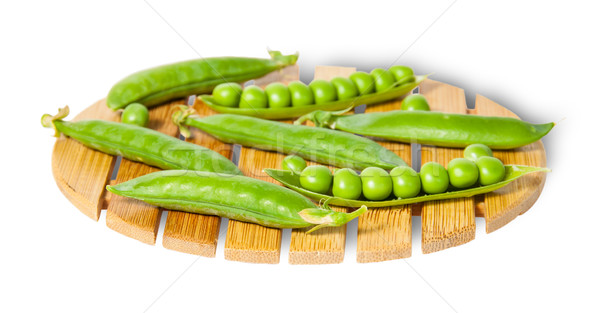 Pods of peas on bamboo small board Stock photo © Cipariss