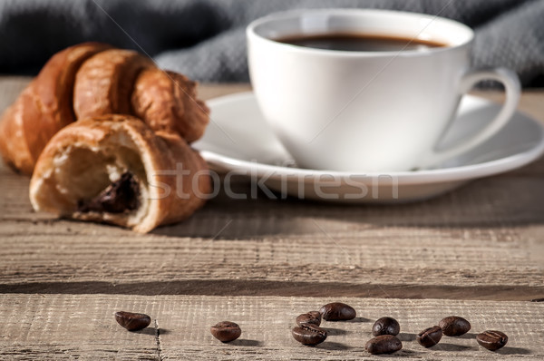 Coffee beans on the wooden table Stock photo © Cipariss