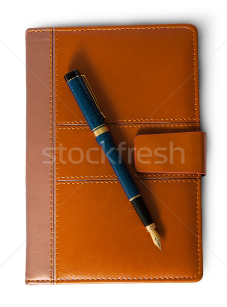 Fountain pen on top of the closed notebook top view Stock photo © Cipariss