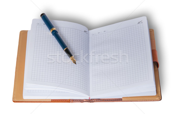 Fountain pen on top of a notebook Stock photo © Cipariss