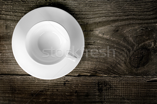 Stock photo: Empty coffee cup on wooden table