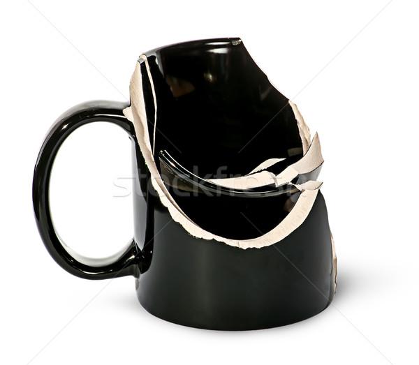 Gebroken zwarte keramische beker binnenkant geïsoleerd Stockfoto © Cipariss