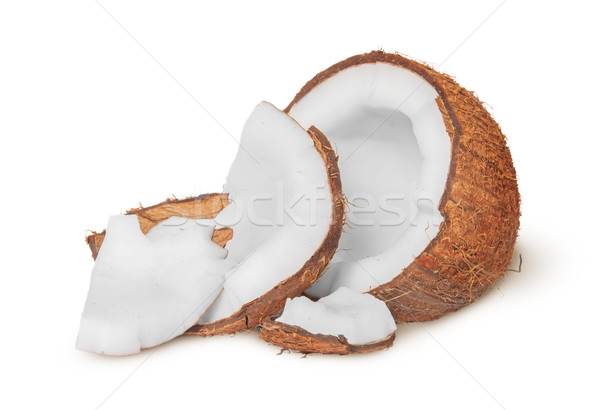 Half coconut with a few pieces of pulp Stock photo © Cipariss