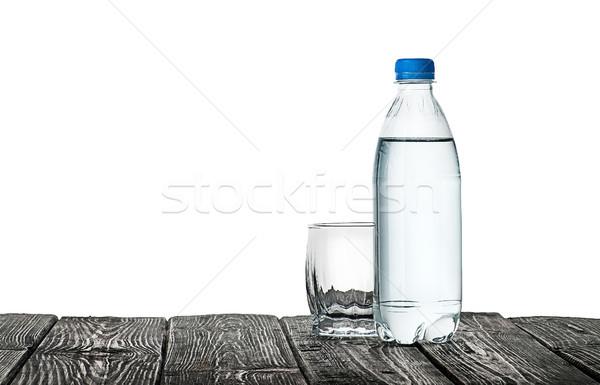 Boş cam şişe su plastik ahşap masa Stok fotoğraf © Cipariss