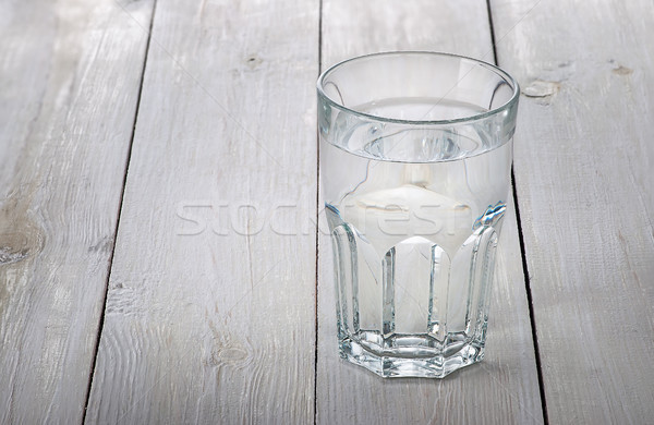 Glass of water on white wooden table Stock photo © Cipariss