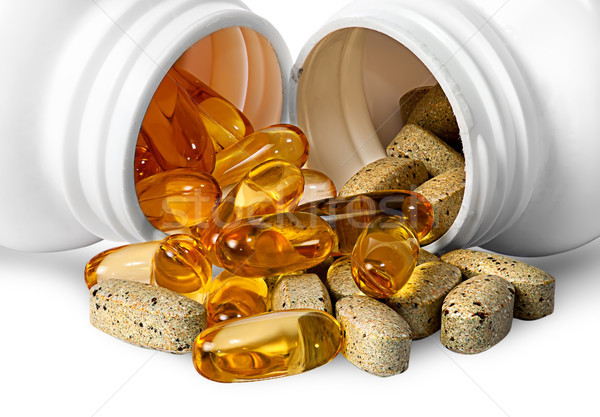 Vitamins and fish oil capsules together Stock photo © Cipariss