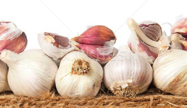 Pile of whole and cloves of garlic on sackcloth Stock photo © Cipariss