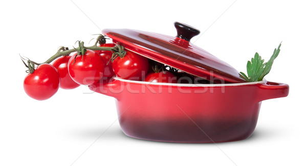 Cherry tomatoes and parsley in saucepan with lid Stock photo © Cipariss
