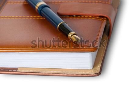 Caneta-tinteiro topo fechado caderno isolado Foto stock © Cipariss