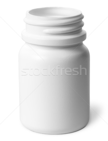 Single plastic bottle of pills without a lid Stock photo © Cipariss
