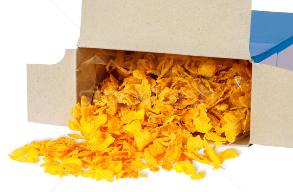 Corn flakes spill out of cardboard box Stock photo © Cipariss