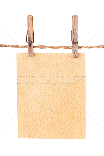 Stock photo: Piece old sheet of paper on two clothespins
