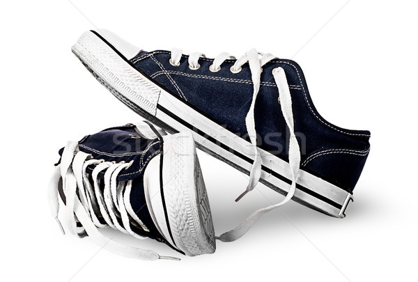 Overturned gym shoes isolated on each other Stock photo © Cipariss