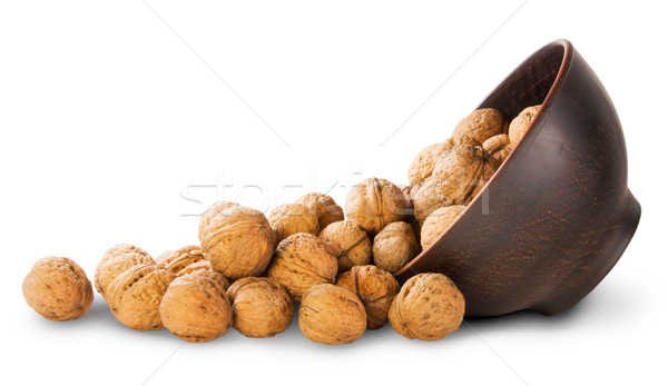 Walnuts Spill Out Of A Clay Bowl Stock photo © Cipariss