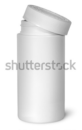 White plastic bottle for vitamins with lid removed Stock photo © Cipariss