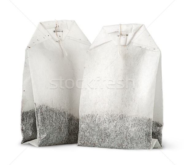 Two tea bags with thread vertically Stock photo © Cipariss