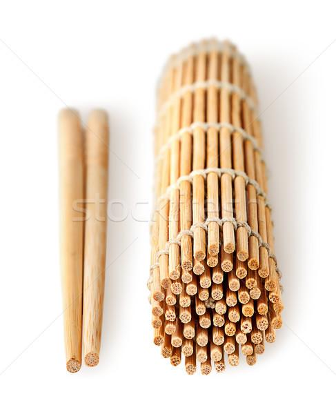 Sushi pałeczki do jedzenia odizolowany biały drewna tle Zdjęcia stock © Cipariss