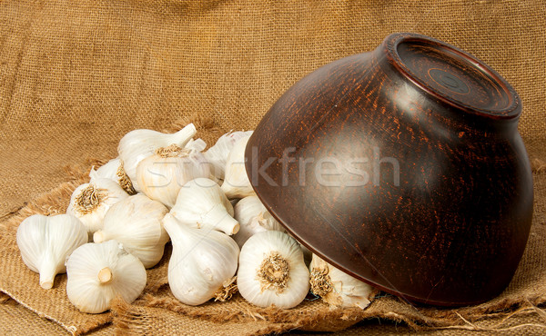 Garlic spill out of a ceramic bowl Stock photo © Cipariss