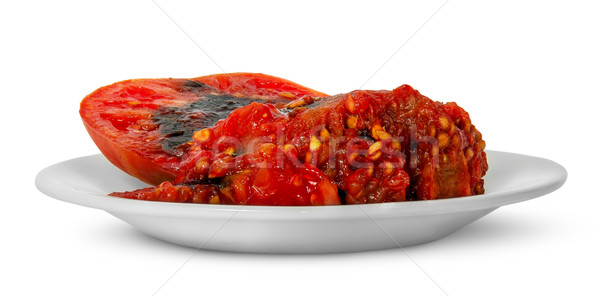 Rotting tomato on white plate Stock photo © Cipariss