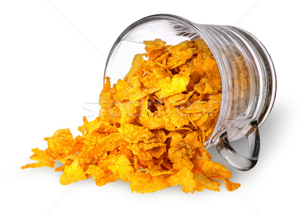 Cornflakes spill out of a glass cup Stock photo © Cipariss