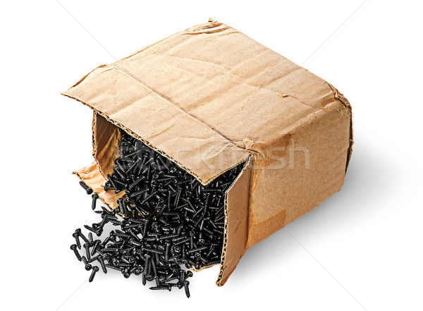 Screws fall out of old cardboard box top view Stock photo © Cipariss
