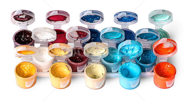Set of colorful acrylic paints in open jars Stock photo © Cipariss