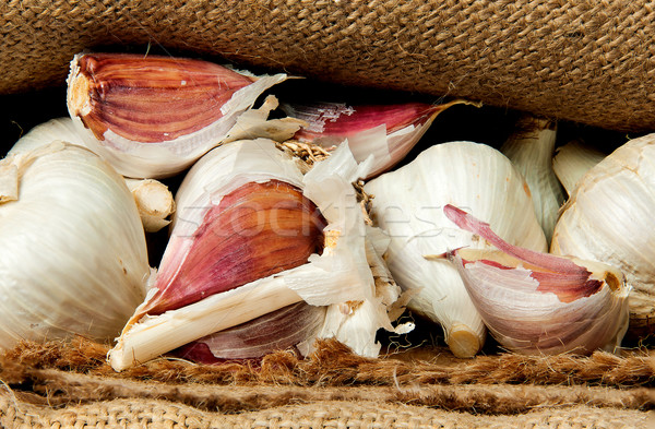 Whole garlic and cloves of garlic in a sack Stock photo © Cipariss