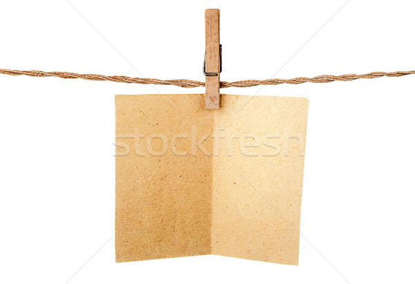 Stock photo: Piece old sheet of paper on clothespins