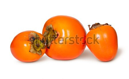 Three Whole Persimmons Stock photo © Cipariss