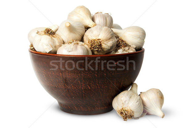 Whole head of garlic in ceramic bowl Stock photo © Cipariss