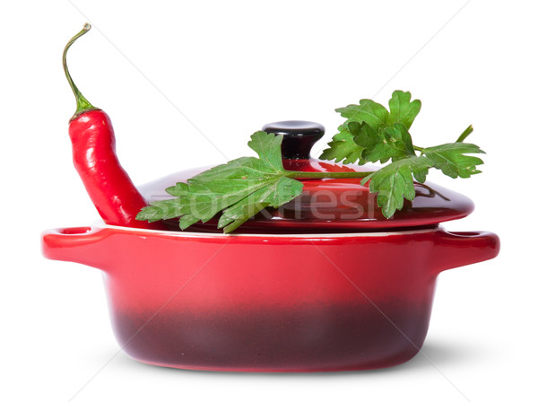 Red pepper in saucepan with lid and parsley on top Stock photo © Cipariss