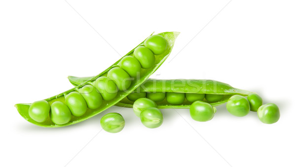 Two disclosed pea pods and peas Stock photo © Cipariss
