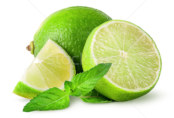 Whole and few pieces of lime with mint Stock photo © Cipariss