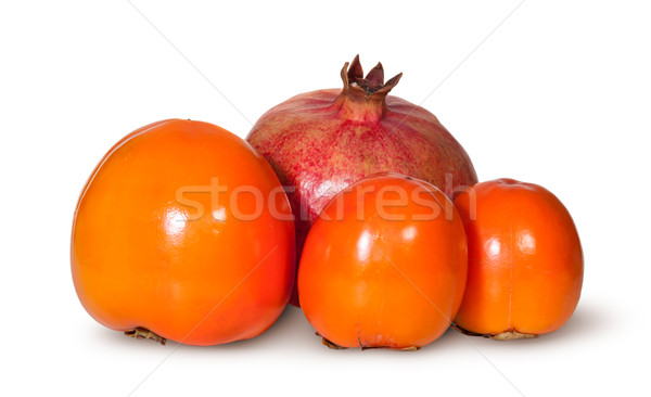 Three Persimmon And One Pomegranate Fruit Stock photo © Cipariss