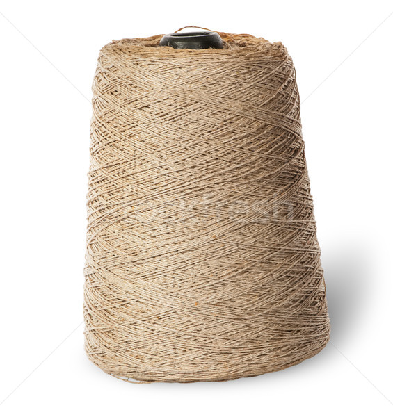 Vertical bobbin of old dirty thread beige Stock photo © Cipariss