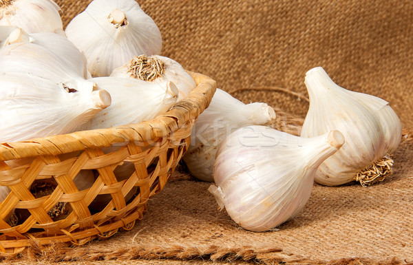 Whole head of garlic in a wicker basket Stock photo © Cipariss
