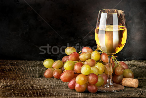 Glass of white wine with grapes Stock photo © Cipariss