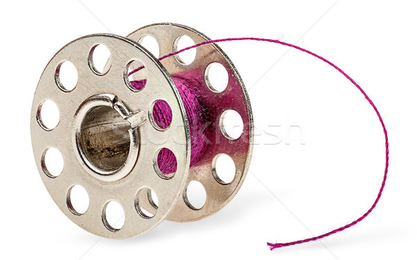 Metal spool with burgundy thread Stock photo © Cipariss