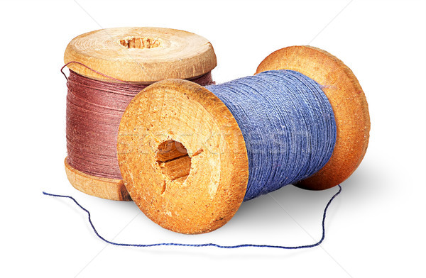 Two different colored thread on wooden spools Stock photo © Cipariss