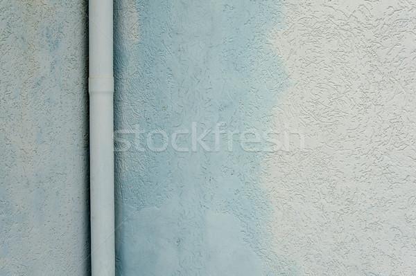 Tube on a grunge wall Stock photo © cla78