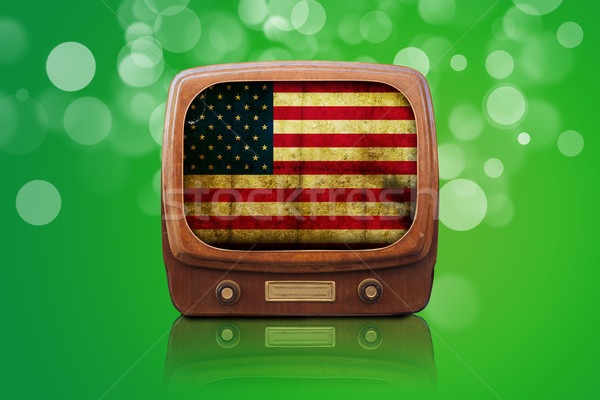 Old Tv isolated on a green bokeh background Stock photo © cla78