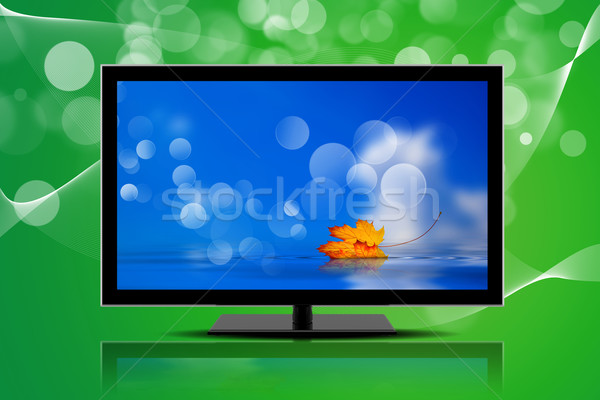 Television isolated on a green background Stock photo © cla78